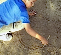 Drawing circle in dirt.